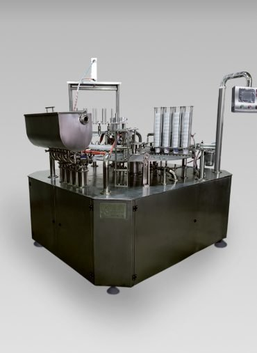Rotary filling and sealing machines